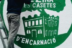 El nostre logo, ben gros al carrer Encarnació.